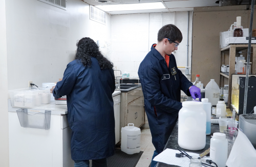 Two chemists working in lab