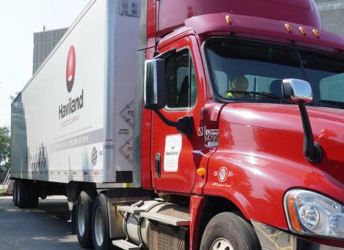Red Haviland semi truck in loading area