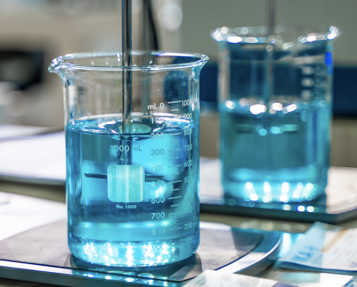 Beaker containing blue chemical