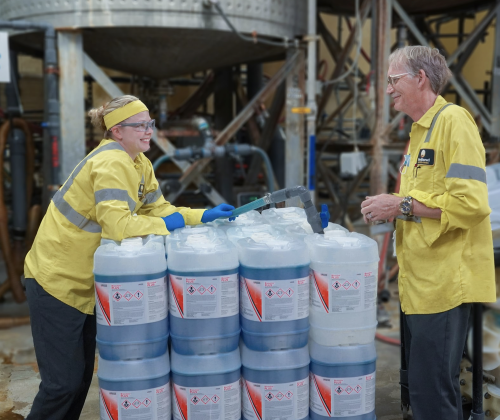 Two employees filling containers