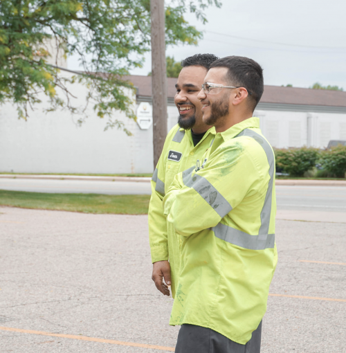 Two employees laughing on break